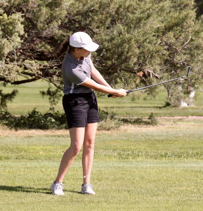 Darby Eakin chips out of the fairway..jpg