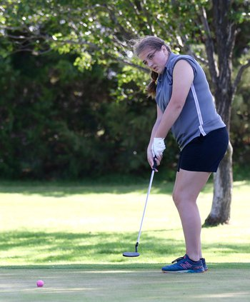 Faith Thompson watches her ball into the hole..jpg