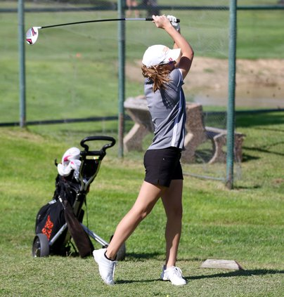 Halle Barker finishes her swing..jpg